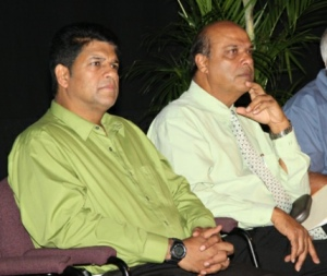 Legal Affairs Minister Prakash Ramadhar, left, Fazal Karim, Science, Technology and Tertiary Education Minister, right, listen attentively to the landlords during yesterday's discussion. Photo: Jennifer Watson. Courtesy Trinidad Guardian