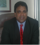Dr. the Honourable Roodal Moonilal, Minister of Housing and Environment