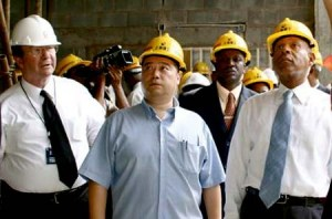 Shanghai Construction head, Michael Qing Zhang, centre, with former PM Patrick Manning, right, and Calder Hart of UDeCOTT touring NAPA under construction.