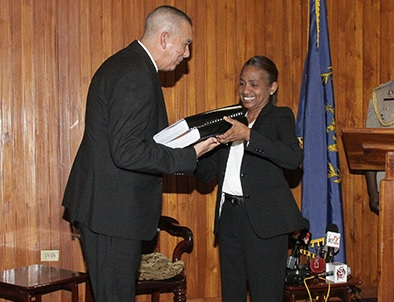 President Anthony Carmona receives the report of the commission of enquiry into Clico from secretary to the commission, Judith Gonzales, at the Office of the President, St Ann's, yesterday. © 2016, T&T Guardian.